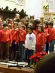 Una poesia natalizia prima dell'esibizione del Coro Le Mille Gru